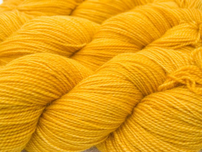 Semi-solid barley gold superwash Bluefaced Leicester (BFL) 4-ply/fingering/sock yarn. Hand-dyed by Triskelion Yarn