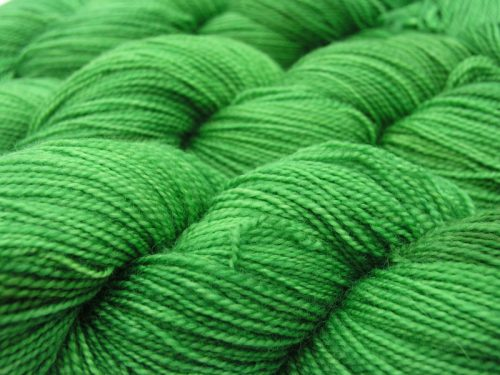 Semi-solid pasture green superwash Bluefaced Leicester (BFL) 4-ply/fingering/sock yarn. Hand-dyed by Triskelion Yarn