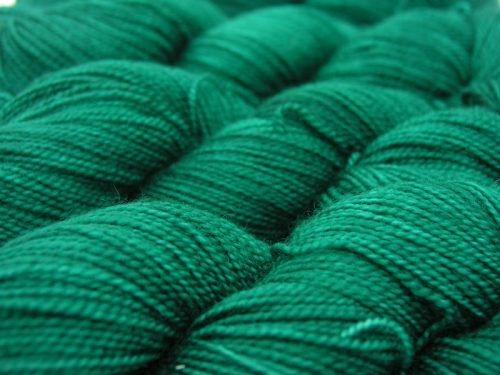 Semi-solid deep woodland green superwash Bluefaced Leicester (BFL) 4-ply/fingering/sock yarn. Hand-dyed by Triskelion Yarn
