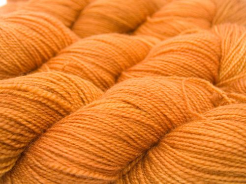 Semi-solid light fiery orange superwash Bluefaced Leicester (BFL) 4-ply/fingering/sock yarn. Hand-dyed by Triskelion Yarn