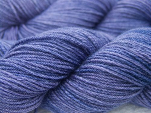 Mid-tone purple Bluefaced Leicester, silk & cashmere double knit yarn. Hand-dyed by Triskelion Yarn.