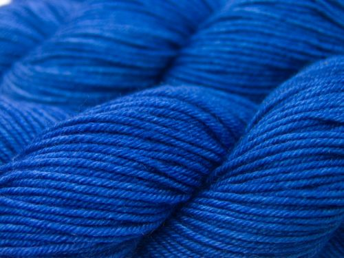 Deep indigo blue Bluefaced Leicester, silk & cashmere double knit yarn. Hand-dyed by Triskelion Yarn.