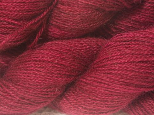 Semi-solid deep red-violet hand-dyed Wensleydale DK/ Double Knit yarn. Hand-dyed by Triskelion Yarn