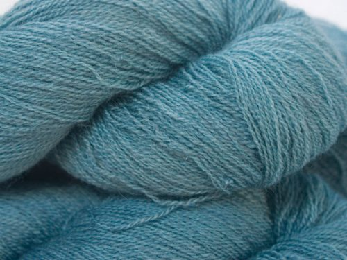 Semi-solid sky blue Bluefaced Leicester laceweight yarn hand-dyed by Triskelion Yarns