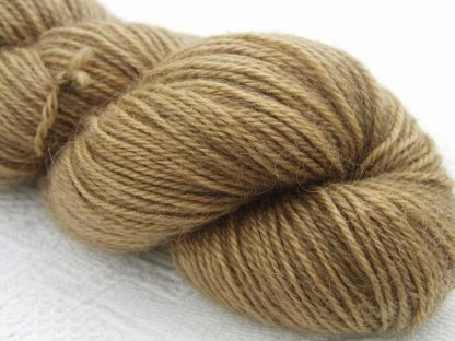 Light golden brown (oak) hand-dyed Wensleydale DK/ Double Knit yarn. Hand-dyed by Triskelion Yarn
