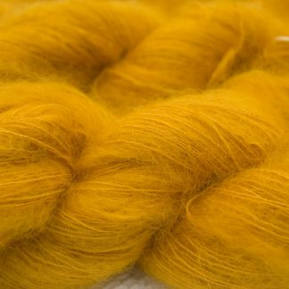 Ochre yellow kidsilk laceweight yarn. Hand-dyed by Triskelion Yarn