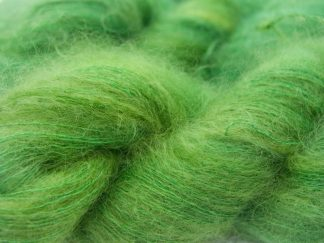 Grassy green kidsilk laceweight yarn. Hand-dyed by Triskelion Yarn