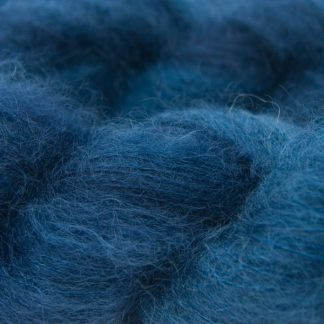 Smoky dark blue kidsilk laceweight yarn. Hand-dyed by Triskelion Yarn
