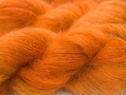 Mid orange kidsilk laceweight yarn. Hand-dyed by Triskelion Yarn