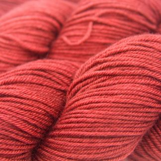 Mid-tone orange-red Bluefaced Leicester, silk & cashmere double knit yarn. Hand-dyed by Triskelion Yarn.