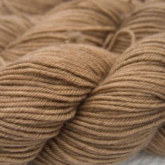 Light to mid-tone golden brown Bluefaced Leicester, silk & cashmere double knit yarn. Hand-dyed by Triskelion Yarn.