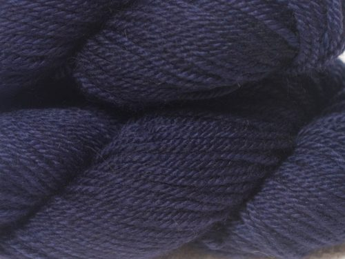 Semi-solid deep purple and blue-violet Bluefaced Leicester (BFL) / Masham aran yarn. Hand-dyed by Triskelion Yarn