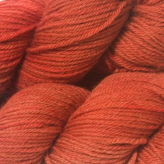 Orange red superwash British Bluefaced Leicester sportweight yarn. hand-dyed by Triskelion Yarn