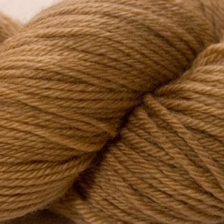 Light brown superwash British Bluefaced Leicester sportweight yarn. hand-dyed by Triskelion Yarn