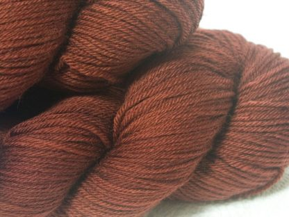 Chestnut brown superwash British Bluefaced Leicester sportweight yarn. hand-dyed by Triskelion Yarn