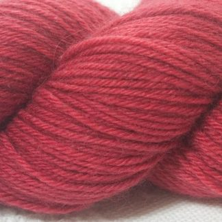Rose superwash British Bluefaced Leicester sportweight yarn. hand-dyed by Triskelion Yarn