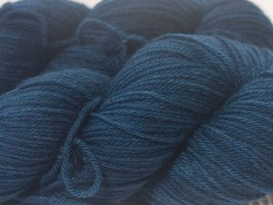 Dark petrel blue superwash British Bluefaced Leicester sportweight yarn. hand-dyed by Triskelion Yarn
