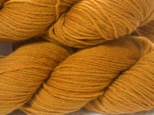 Orange superwash British Bluefaced Leicester sportweight yarn. hand-dyed by Triskelion Yarn