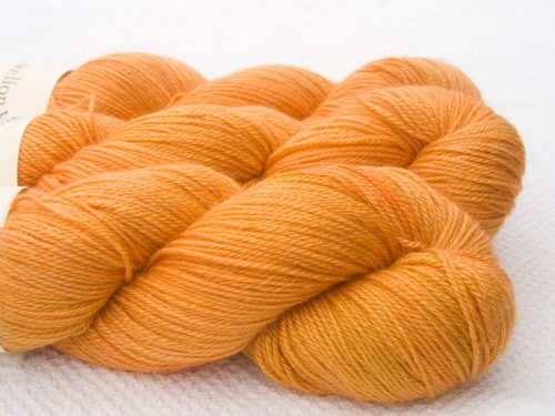 Orange Bluefaced Leicester, silk & cashmere 4-ply yarn. Hand-dyed by Triskelion Yarn.