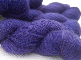Deep purple Bluefaced Leicester, silk & cashmere 4-ply yarn. Hand-dyed by Triskelion Yarn.