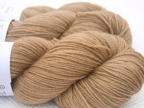 Light Brown Bluefaced Leicester, silk & cashmere 4-ply yarn. Hand-dyed by Triskelion Yarn.