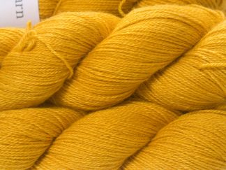 Yellow Baby Alpaca Silk & Cashmere 4-ply yarn. Hand-dyed by Triskelion Yarn.