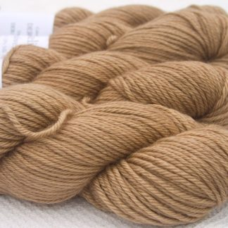 Light brown Baby Alpaca Silk & Cashmere double-knit yarn. Hand-dyed by Triskelion Yarn.