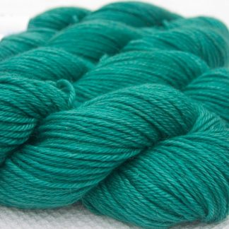 Turquoise green Baby Alpaca Silk & Cashmere double-knit yarn. Hand-dyed by Triskelion Yarn.