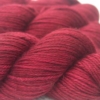 Rose Baby Alpaca Silk & Cashmere double-knit yarn. Hand-dyed by Triskelion Yarn.