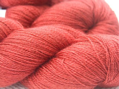 Orange red Bluefaced Leicester laceweight yarn. Hand-dyed by Triskelion Yarn.