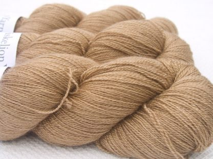 Light brown Bluefaced Leicester laceweight yarn. Hand-dyed by Triskelion Yarn.