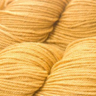 Sandy golden yellow Bluefaced Leicester, silk & cashmere double knit yarn. Hand-dyed by Triskelion Yarn.