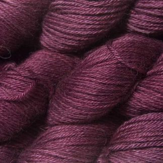 Mid-tone violet red Baby Alpaca Silk & Cashmere double-knit yarn. Hand-dyed by Triskelion Yarn.