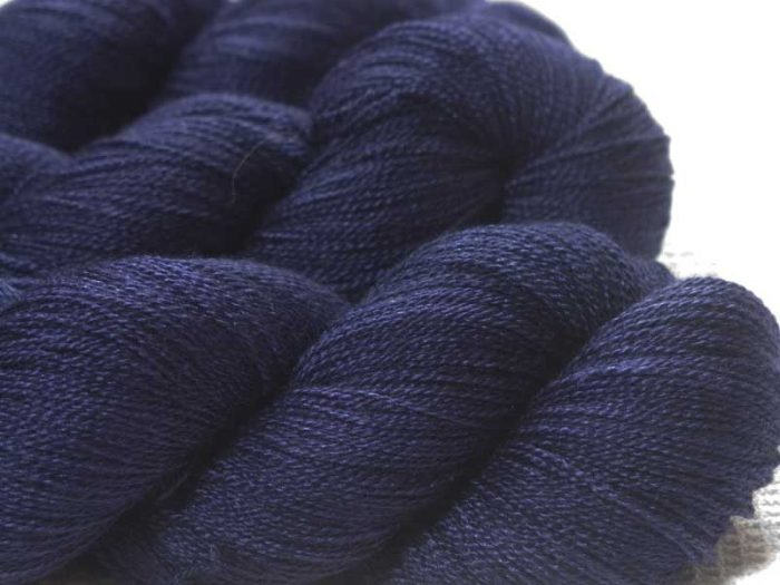 Semi-solid deep purple and blue-violet Bluefaced Leicester laceweight yarn. Hand-dyed by Triskelion Yarn.