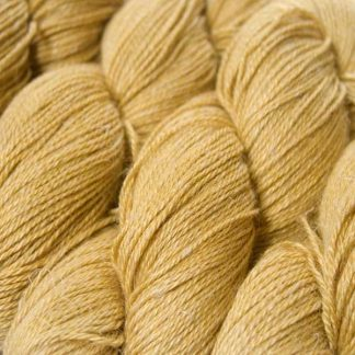 Sandy golden yellow Baby Alpaca, silk and linen 4-ply yarn. Hand-dyed by Triskelion Yarn.