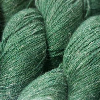 Deep forest green Baby Alpaca, silk and linen 4-ply yarn. Hand-dyed by Triskelion Yarn.