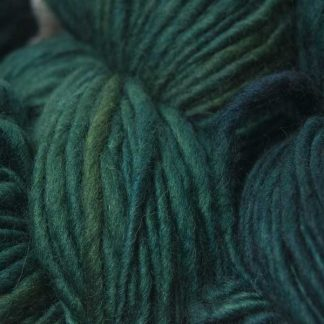 Mid to dark teal green Corriedale thick and thin slub yarn. Hand-dyed by Triskelion Yarn.