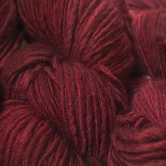 Deep, rich red Corriedale thick and thin slub yarn. Hand-dyed by Triskelion Yarn.