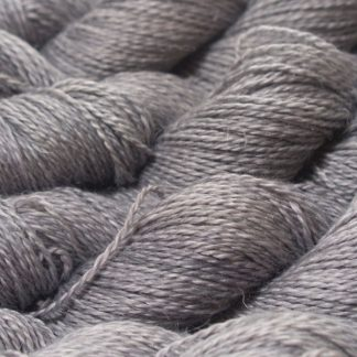 Light to mid neutral grey Baby Alpaca, silk and linen sport weight yarn. Hand-dyed by Triskelion Yarn.