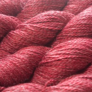 Semi-solid deep red Baby Alpaca, silk and linen sport weight yarn. Hand-dyed by Triskelion Yarn.