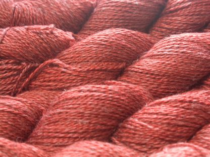 Fiery orange-red Baby Alpaca, silk and linen sport weight yarn. Hand-dyed by Triskelion Yarn.