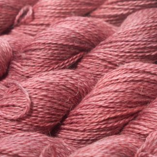 Semi-solid vibrant rose pink Baby Alpaca, silk and linen sport weight yarn. Hand-dyed by Triskelion Yarn.