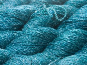 Mid to dark teal Baby Alpaca, silk and linen sport weight yarn. Hand-dyed by Triskelion Yarn.