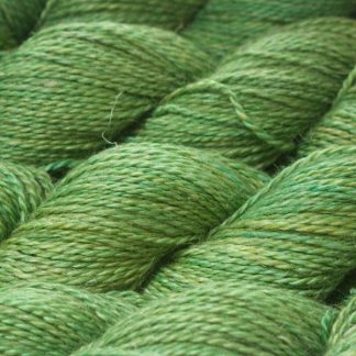 Mid-tone grassy green Baby Alpaca, silk and linen sport weight yarn. Hand-dyed by Triskelion Yarn.
