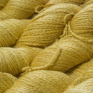 Pale, fresh yellow Baby Alpaca, silk and linen sport weight yarn. Hand-dyed by Triskelion Yarn.