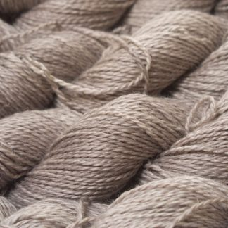 Light pebble grey Baby Alpaca, silk and linen sport weight yarn. Hand-dyed by Triskelion Yarn.