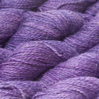Semi-solid mid-tone purple Baby Alpaca, silk and linen sport weight yarn. Hand-dyed by Triskelion Yarn.