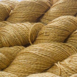 Sandy golden yellow Baby Alpaca, silk and linen sport weight yarn. Hand-dyed by Triskelion Yarn.