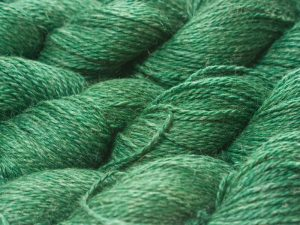 Deep forest green Baby Alpaca, silk and linen sport weight yarn. Hand-dyed by Triskelion Yarn.
