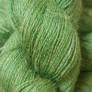 Mid-tone grassy green Baby Alpaca, silk and linen heavy laceweight yarn. Hand-dyed by Triskelion Yarn.